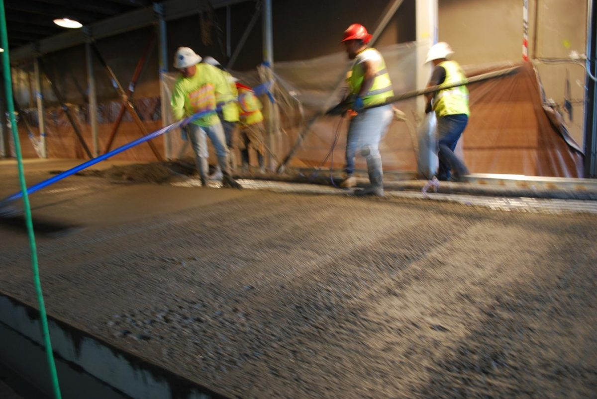 On August 17th,  facing an eminent strike by concrete workers, this crew manages to pour and finish the floor  of the cardio and trainers rooms.  this area extends of the stage in the main gym.