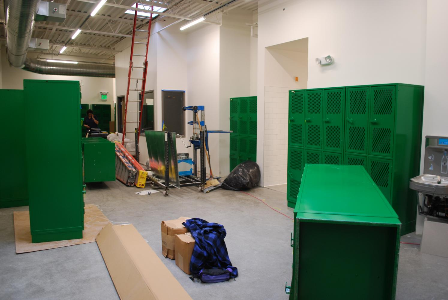 Saturday crews work to stay on target for the October 11th deadline.  This crew looks like it is playing Tetris, getting all of the locker to fit in the girl's locker room.