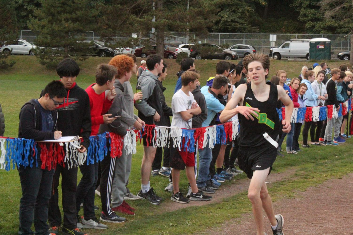 Drew Schornak, an avid participant in winter training, is seen here running down the chute to the finish line during his 2017 cross country season.