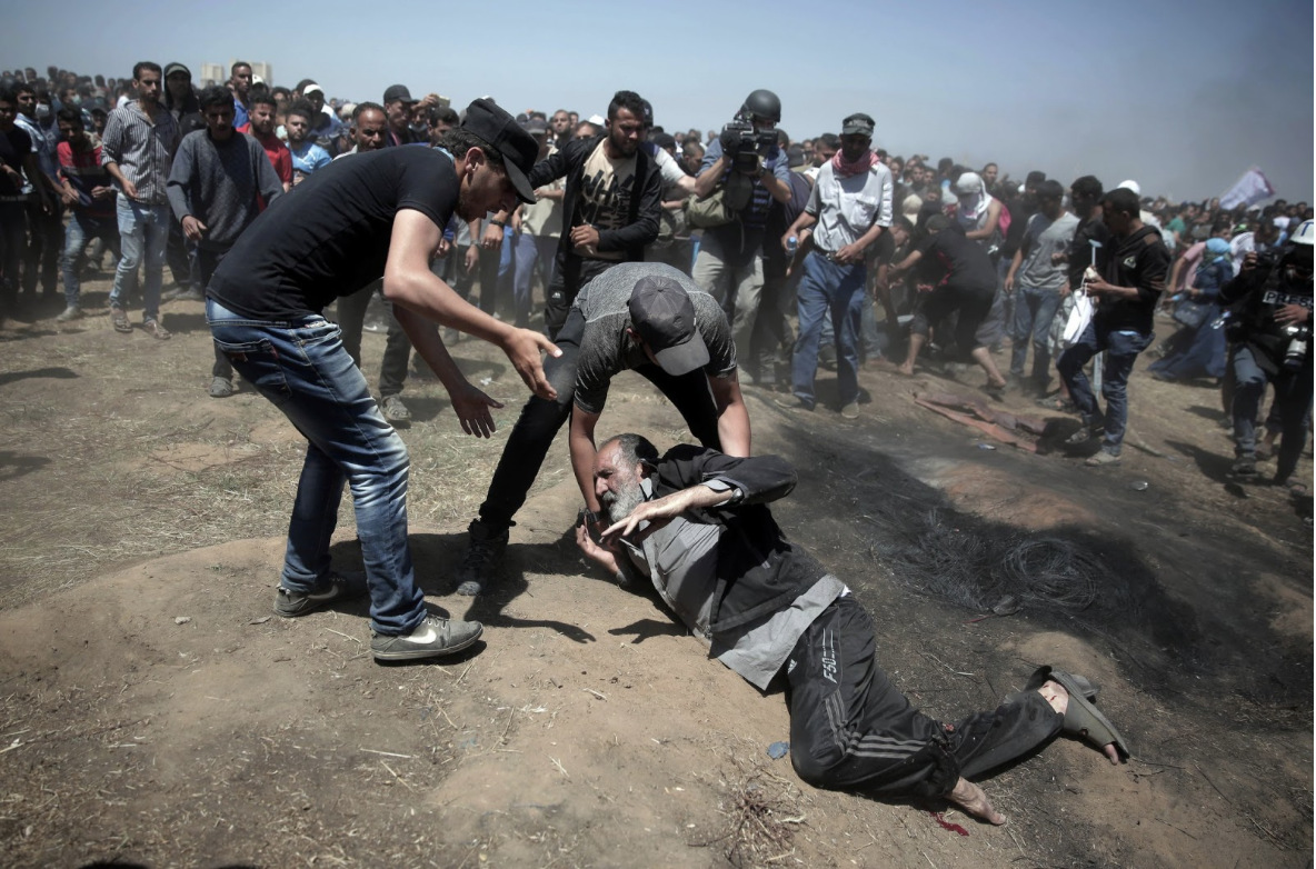 NOT BACKING DOWN : An elderly man lays fallen on the ground during the protests taking place on the border of Gaza, after the opening of the US Embassy in Jerusalem. These protests quickly became violent, leaving over 2,000 people wounded. May 14, the opening day of the embassy, is now the bloodiest day on the Gaza Strip has seen since 2014. New York Times