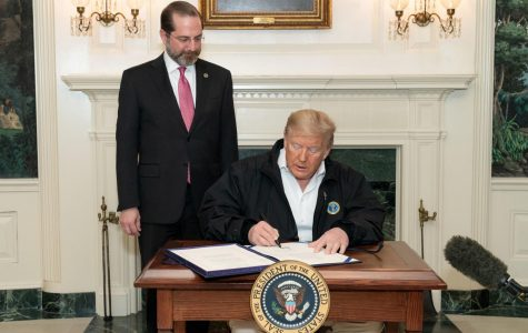 President Donald J. Trump, joined by Secretary of Health and Human Services Alex Azar, signs the congressional funding bill for coronavirus response Friday, March 6, 2020, in the Diplomatic Reception Room of the White House.