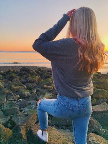 Seattle Prep senior showcases her pink hair at sunset.