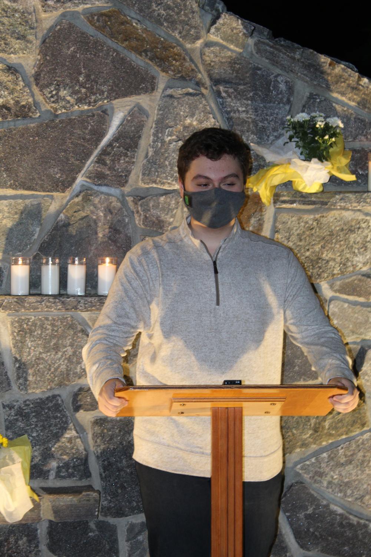 Andre Laze reads the Gospel